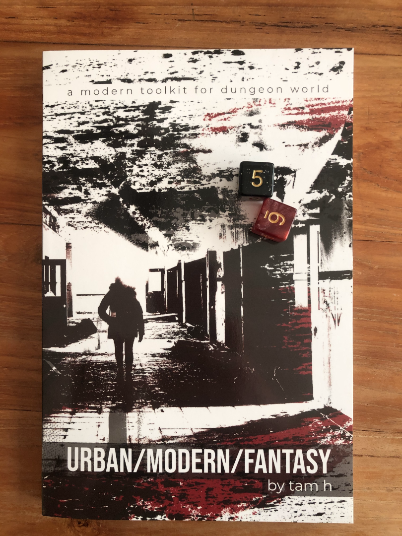 the black and red cover, a woman in sillhouette walking in an abandoned hall, a second face in the upper corner, with regular dice for scale