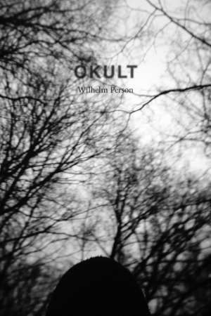 Okult cover depicting a copse of dead trees
